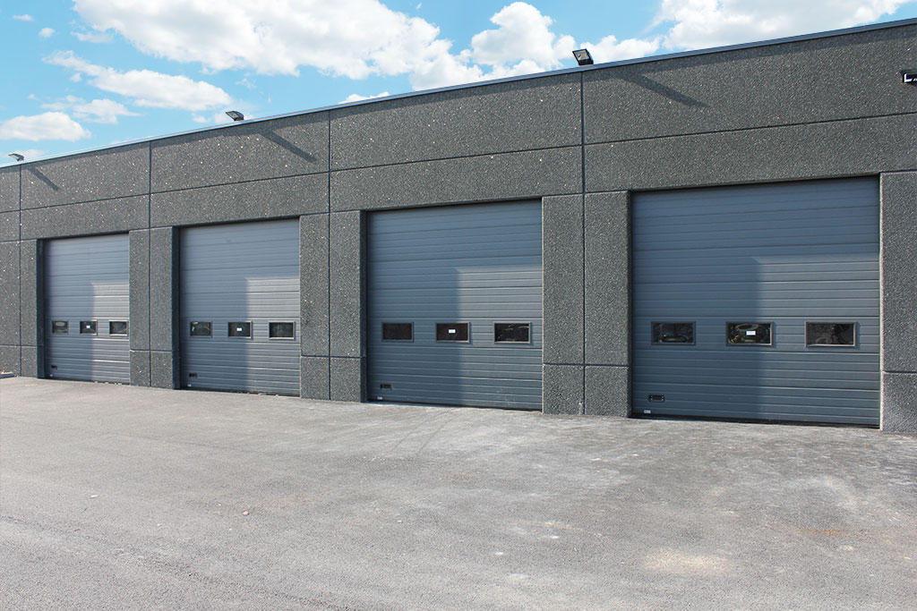 Portes industrielles sectionnelles motoris es smf services - Porte de garage industrielle occasion ...